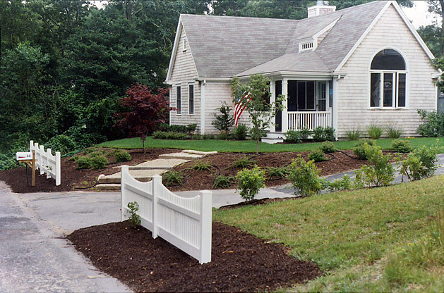 4 finished lawn with landscaped loam hill - steps and white picket fence