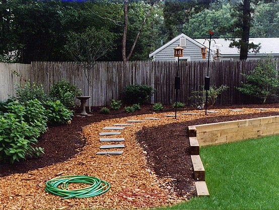 3 backyard fence abutted slate path with retaining wall